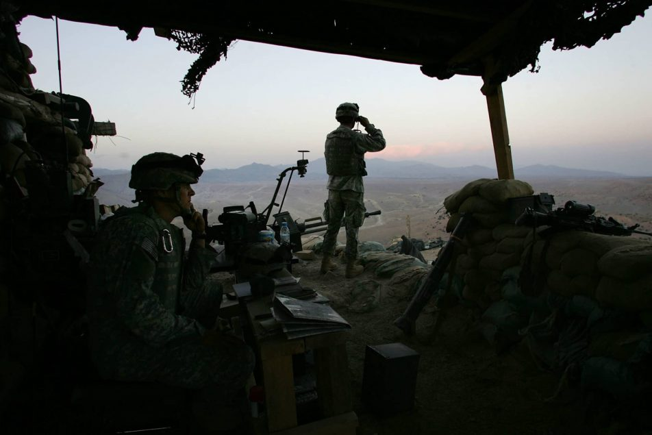 CAMP TILLMAN, AFGHANISTAN - OCTOBER 15:   American soldiers look into Pakistan from an U.S. outpost Oct. 15, 2006 near Camp Tillman, Afghanistan just two kilometers from the Pakistan border. Some 20 Taliban rockets were fired at the U.S. camp manned by soldiers from the 2-87 Infantry just the previous night, although no one was injured. Army officials say that Taliban insurgents continue to mount attacks from the Pakistani side of the border. Camp Tillman was named for Arizona Cardinals football star Pat Tillman, who gave up his NFL career and joined the U.S. Army Rangers to fight in the war on terror. He was killed in 2004 while on combat operations in Afghanistan near the Pakistan border.  (Photo by John Moore/Getty Images)